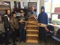 "Students from Mr.Kannals industrial arts class presented Mr.Whiteman with a boat shelf! It symbolizes the ""Row the Boat"" theme used at Foxfire High School that represents the importance of being resilient when facing life's obstacles."